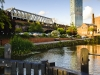 Castlefield canal Manchester. Bright sunny day blue sky beetham hilton hotel canal lock railway viaduct bridge fluffy clouds