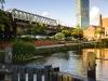 Castlefield canal Manchester. Bright sunny day blue sky beetham hilton hotel canal lock railway viaduct bridge fluffy clouds