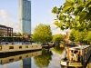 Castlefield canal area Manchester. Bright sunny day with canal and barge in the foreground  Beetham Hilton hotel in background