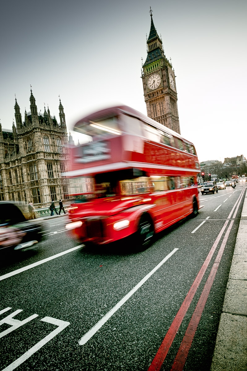 London red bus in front of big ben motion blur