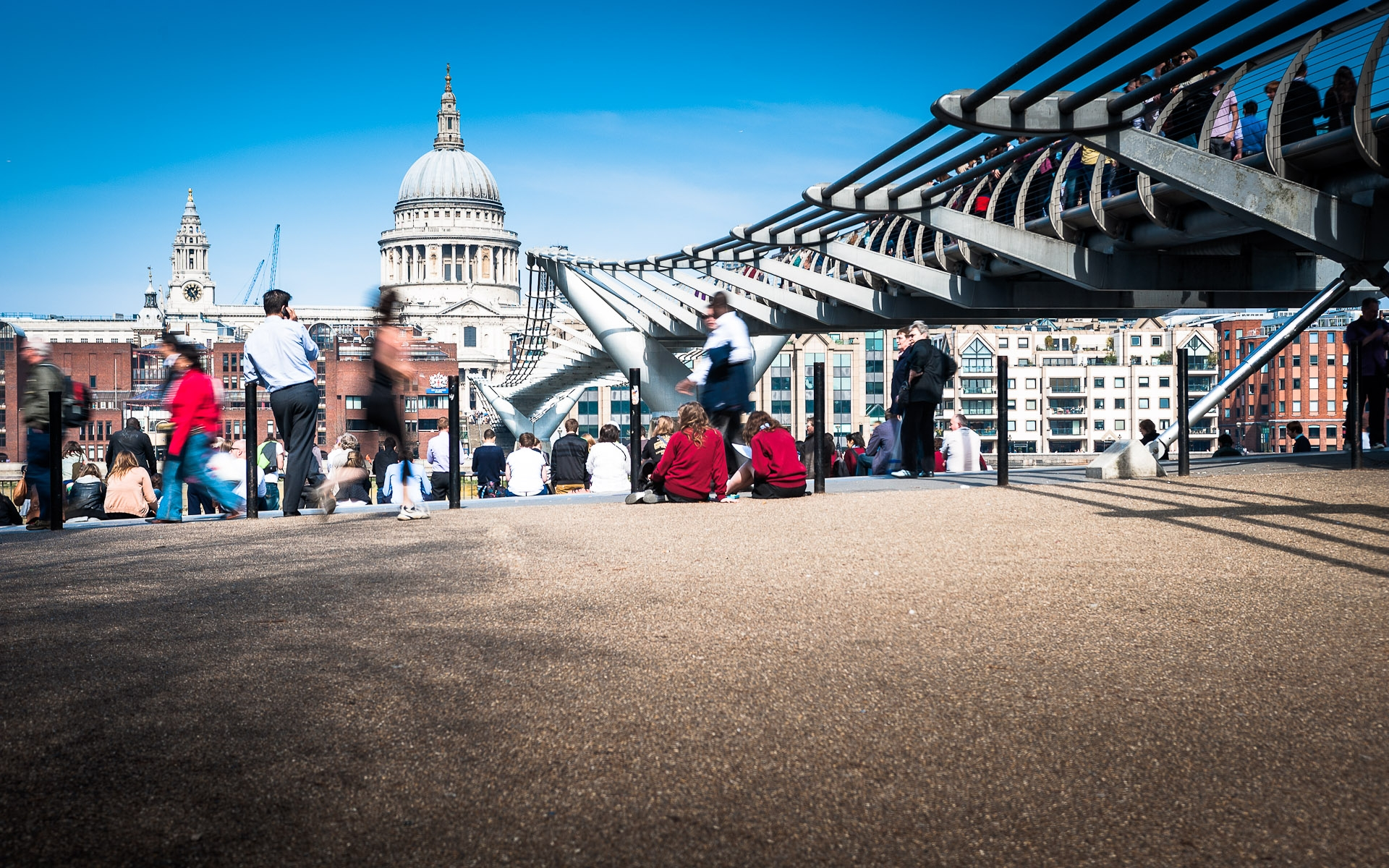 millenium bridge towards st pauls people walking and jogging