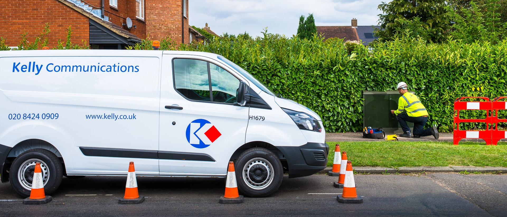Kelly communications van and technician at street broadband cabinet