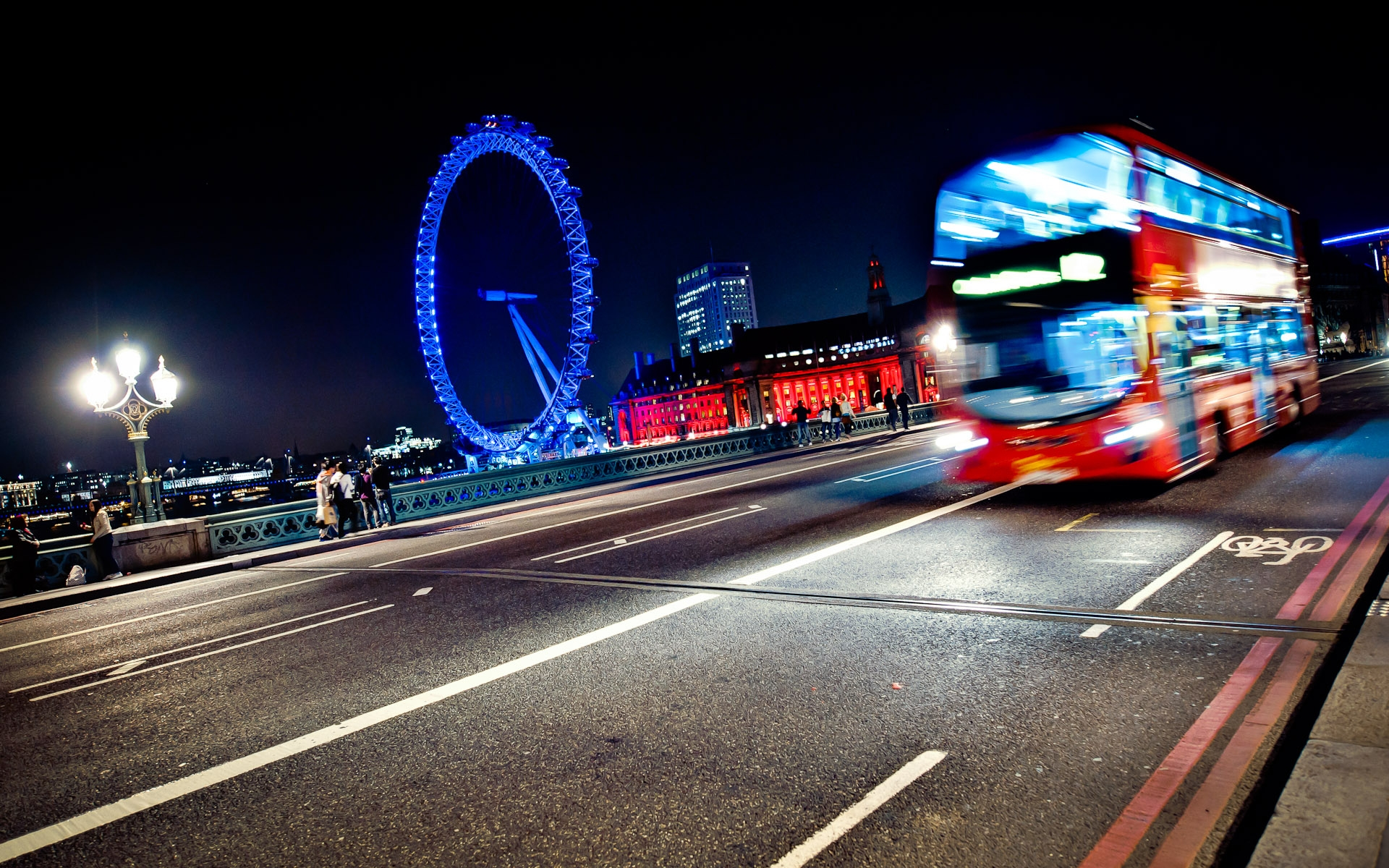 london red bus and london eye at night across Westminster bridge