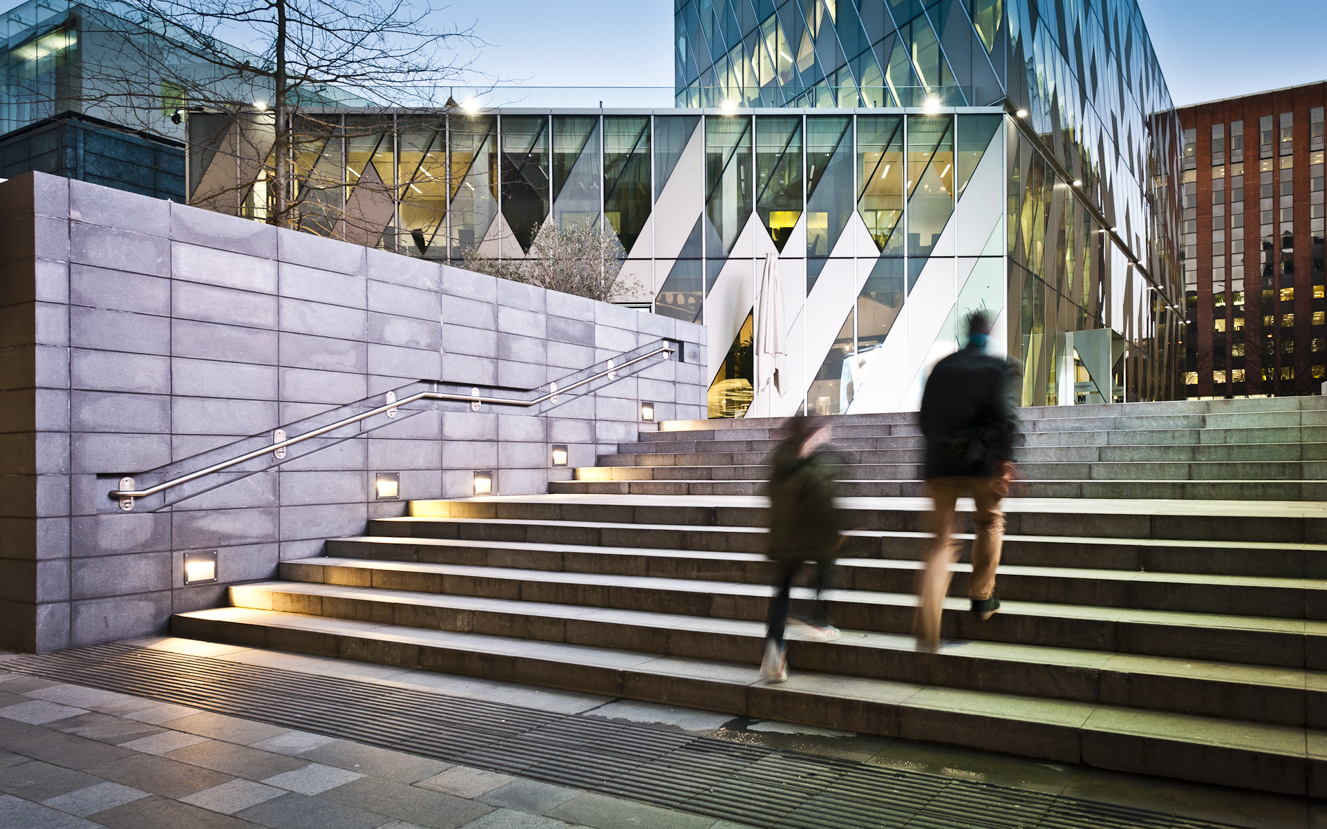 Man and child walking up steps Manchester Spinningfields