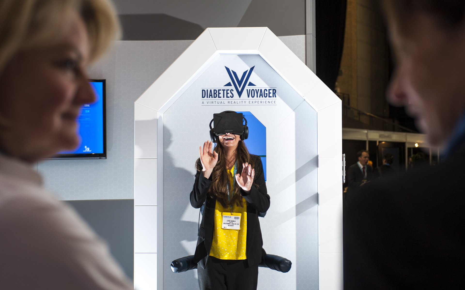 Woman using virtual reality headset at educational expo