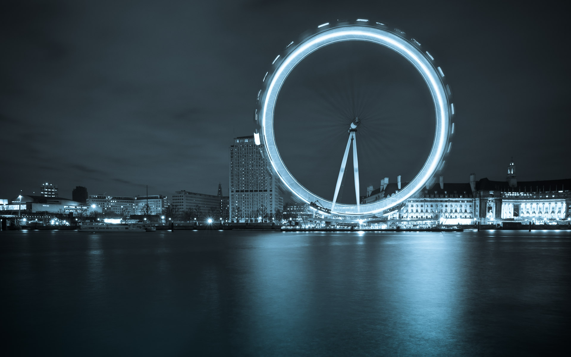 London eye big wheel across thames night slow shutter speed