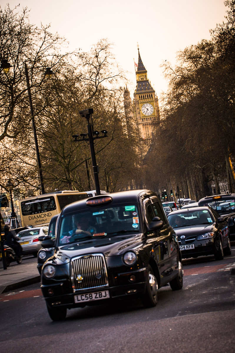 black cab taxi and traffic with big ben in background