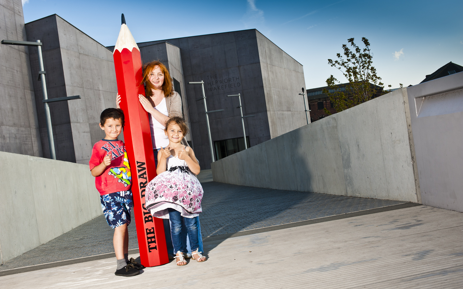 Children and teacher with giant red pencil at Hepworth Wakefield gallery