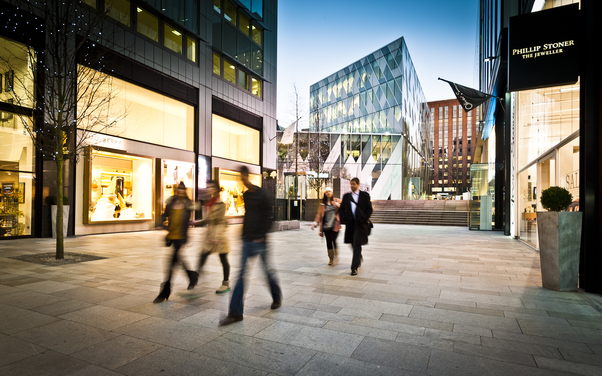 People walking in retail area Manchester Spinningfields
