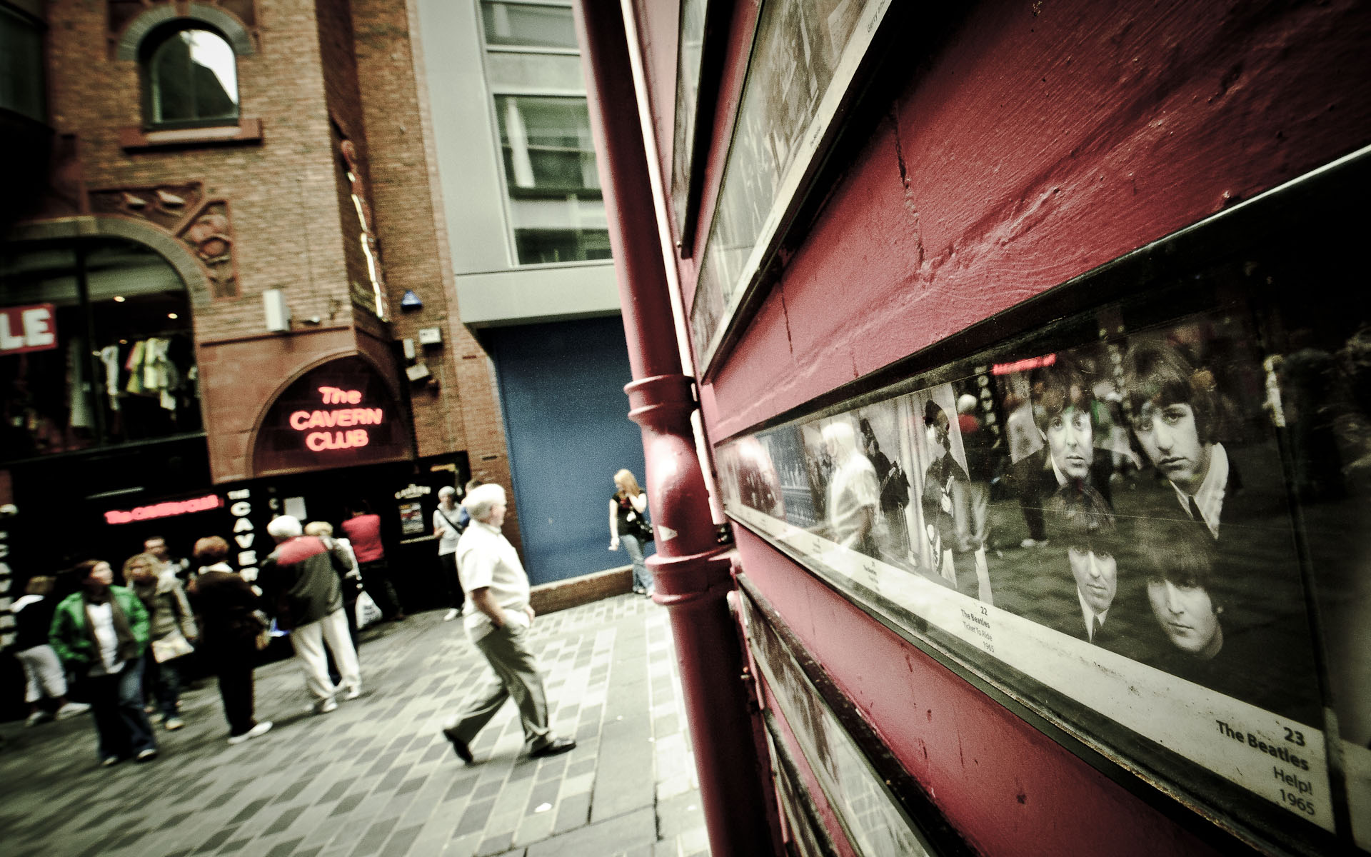 View towards Cavern club liverpool with Beatles photos in foreground