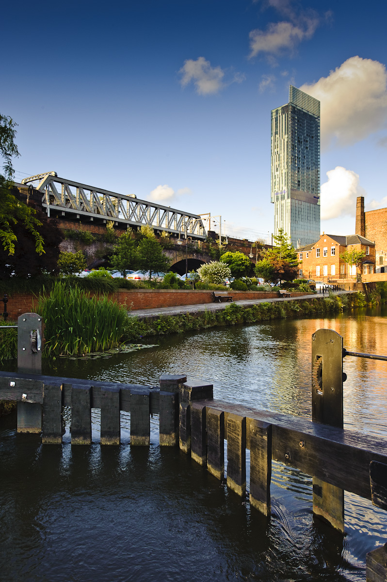 view across manchester canal lock towards beetham tower hilton