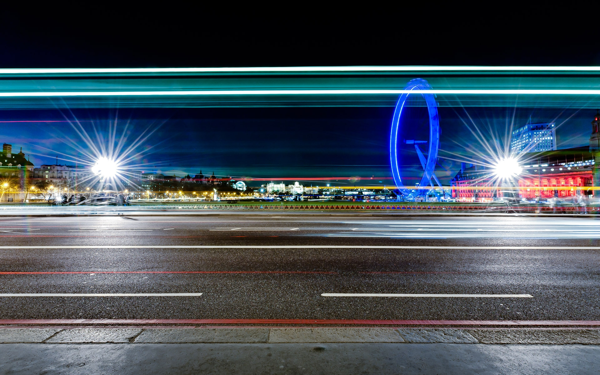 view across westminster bridge to london eye light trails from traffic