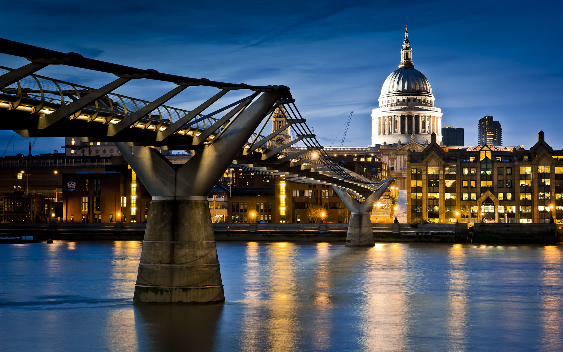 Photo of St Paul's Cathedral across river Thames and Millennium bridge, night, London