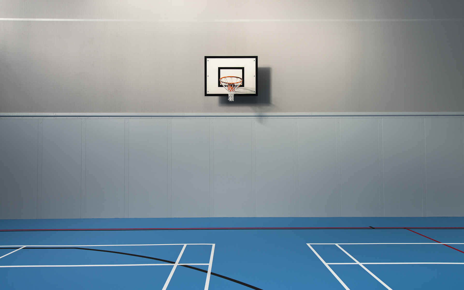 Interior photography shoot of sports hall basketball court