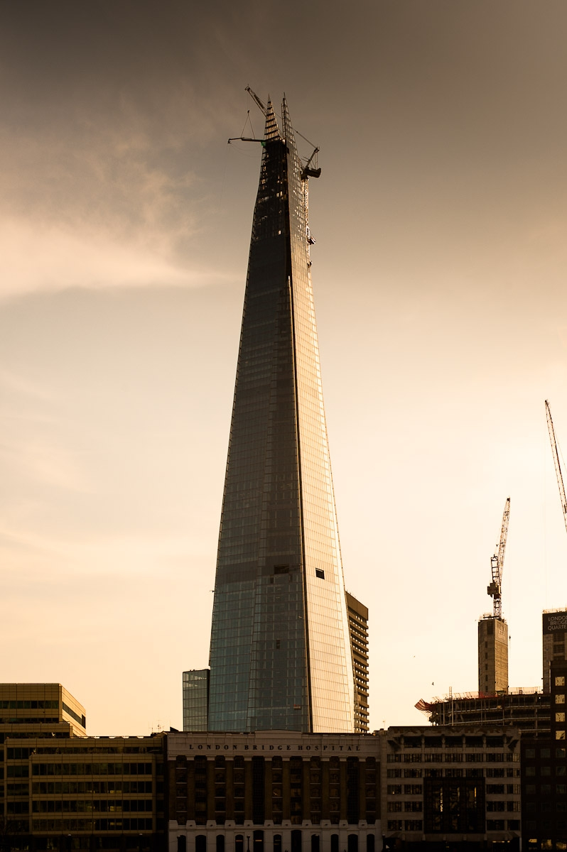 the london shard under construction at dusk