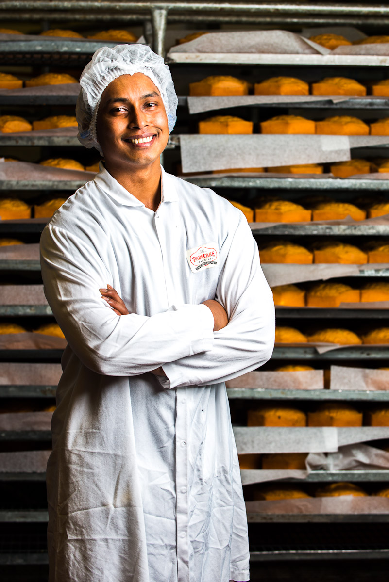 portrait photograph of young male asian baker