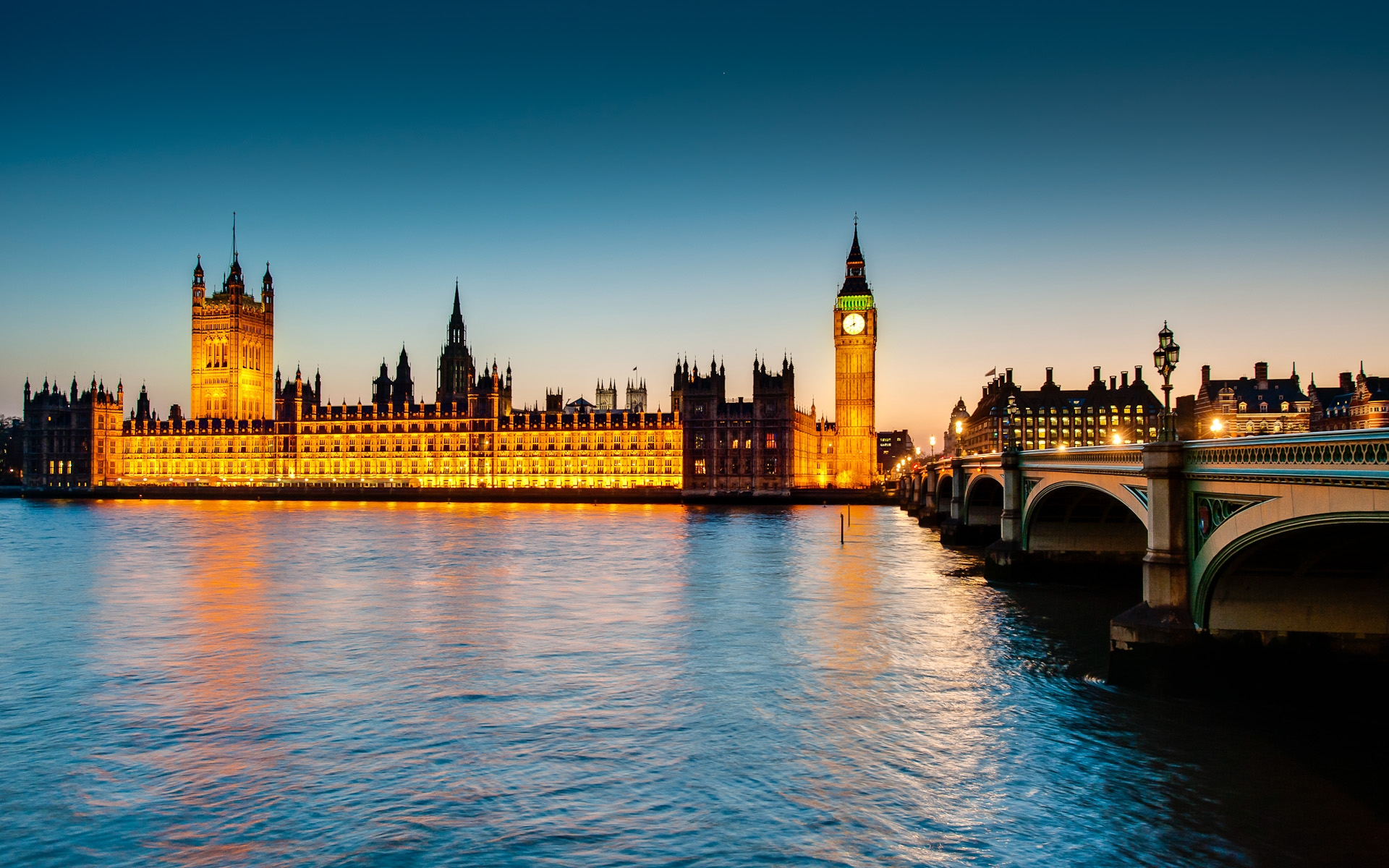 houses of parliament and Westminster bridge at dusk night