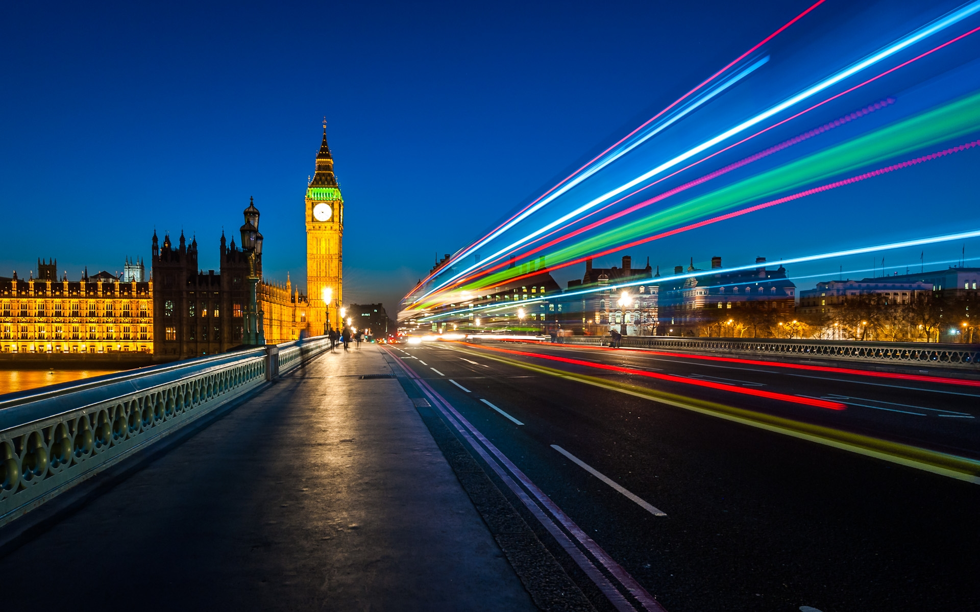 big ben tower houses of parliament light trails from traffic Westminster bridge night