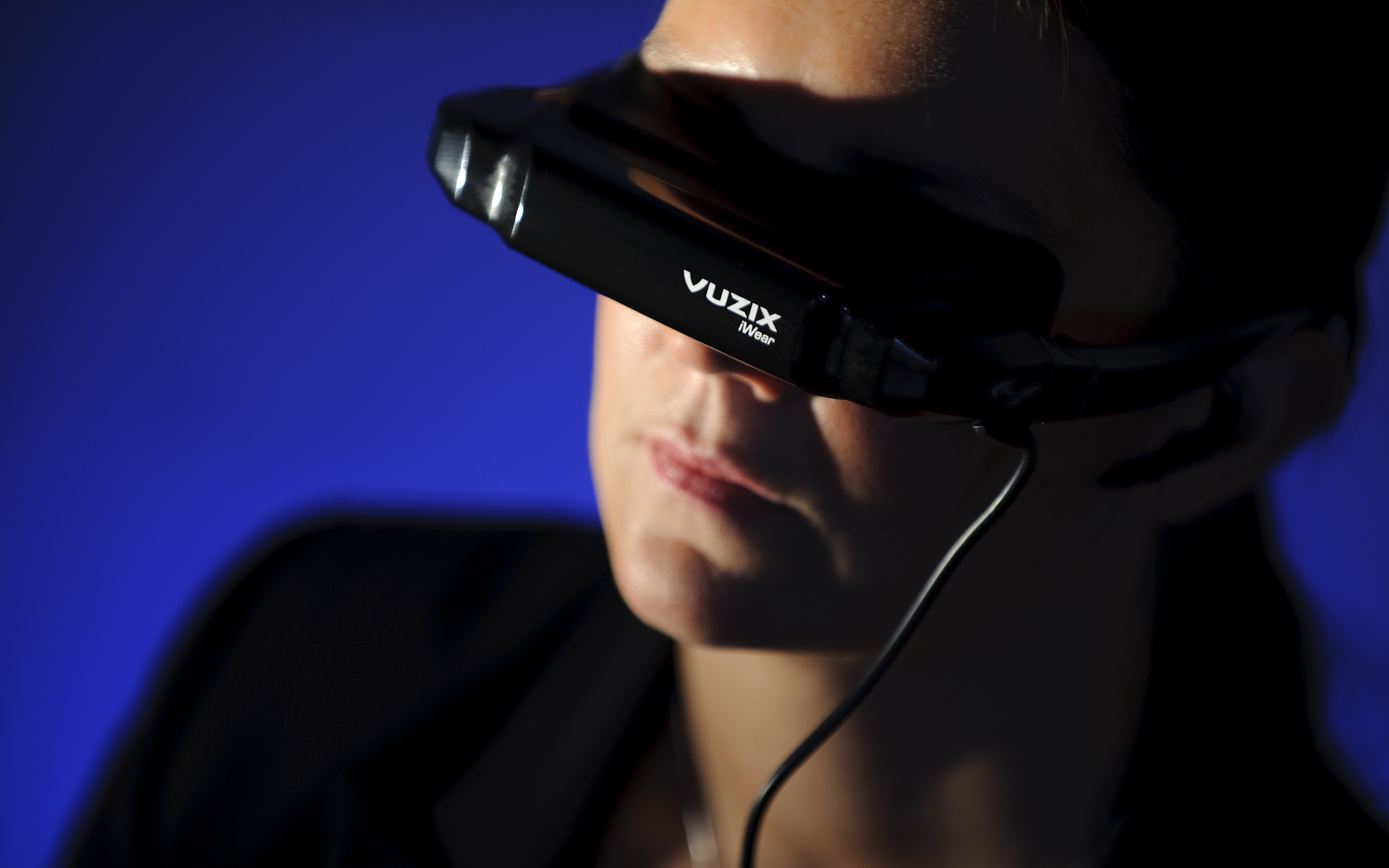 Woman wearing Vuzix iWear headset goggles